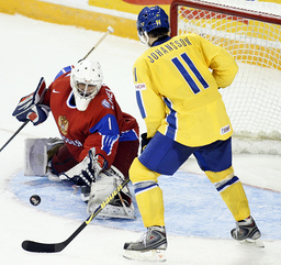 Russia's Zhelobnyuk blocks a shot from Sweden's Johansson at the IIHF U20 World Junior Hockey Championships in Ottawa