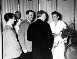Adolf Hitler and party meeting Leni Riefenstahl during a break between showings at the premiere of 'Olympia' at the UFA-Palast, Berlin, 1938 (b/w photo)