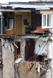 General view of apartments in shattered five-storey block in Black Sea resort of Yevpatoria in Crimea peninsula