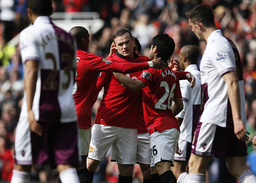 Manchester United's Rooney celebrates after scoring during their English Premier League soccer match against Aston Villa at Old Trafford in Manchester