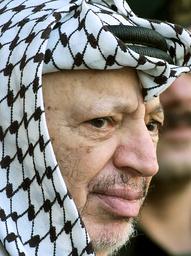 PALESTINIAN PRESIDENT YASSER ARAFAT WAITS FOR THE LATIN PATRIARCH MICHEL SABBAH IN RAMALLAH