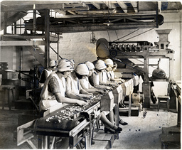 The Huntley & Palmers Ltd Biscuit Factory In Reading 1930 Showing Workers Sorting Almonds On The Factory Floor