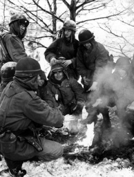 US soldiers at warming fire