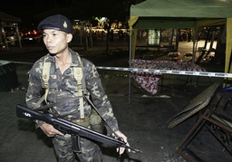Soldier guards after scene after bomb blast in Bangkok