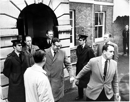 Bruce Reynolds (d 28/2/2013 Handcuffed To A Detective At Linslade Court The Great Train Robbery - A Ii2.6 Million Train Robbery Committed On 8 August 1963 At Bridego Railway Bridge Ledburn Near Mentmore In Buckinghamshire England. The Gang Of Train R