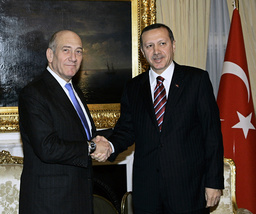 Turkey's Prime Minister Tayyip Erdogan and Israel's Prime Minister Ehud Olmert pose for the media before a meeting in Ankara