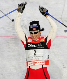 Norway's Bjoergen celebrates after winning the first of four 'Tour de Ski' Cross Country World Cup competitions in Munich's Olympic stadium