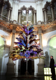 A JOURNALIST VIEWS A CHRISTMAS TREE AT THE TATE BRITAIN IN LONDON