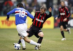 AC Milan's Beckham challenges Sampdoria's Franceschini during Serie A match in Genoa