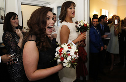 Lesbian couple Sarah Keith and Emma Powell react after their same-sex wedding at the Claremont Hotel in Brighton