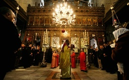 An Eastern Orthodox priest leads the mass at the Church of Nativity in Bethlehem
