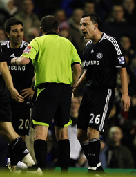 Chelsea's Terry argues with referee Dowd after being sent off during their English Premier League soccer match against Everton in Liverpool