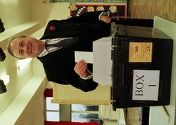 LABOUR'S BEN CHAPMAN VOTES AT A POLLING STATION IN HESWALL