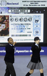 Two schoolchildren call out the winning number during the world's richest lottery, known as El Gordo or the fat one, in Madrid