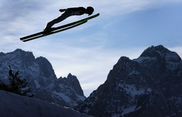 Norway's Anders Jacobsen soars over Germany's highest mountain Zugspitze and Waxenstein during the second practice of the four-hills ski jumping tournament in Garmisch-Partenkirchen