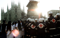RESCUE WORKERS WAIT AT THE ENTRANCE TO DUOMO CATHEDRAL IN MILAN