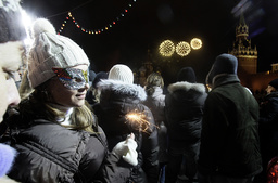 People celebrate New Year's Day on an ice rink in Red Square in Moscow