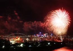 Fireworks explode near the Sydney Harbour Bridge and Opera House during a pyrotechnic show to celebrate the New Year