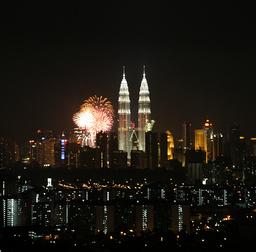 Fireworks explode near Malaysia's landmark Petronas Twin Towers during New Year celebrations in Kuala Lumpur