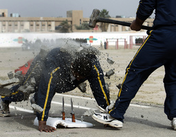 Policemen demonstrate their skills during their graduation ceremony in Baghdad