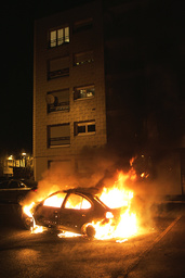 Flames engulf a burning car on New Year's Eve in Strasbourg's western suburb of Hautepierre
