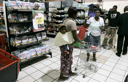 Zimbabweans buy goods at a supermarket in Harare