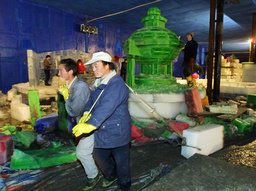 CHINESE WORKERS DELIVER ICE BLOCK FOR THE ART OF ICE EXPOSITION IN BEIJING