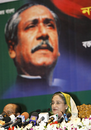 Bangladesh Awami League President and former PM Hasina talks in front of portrait of founder of party during news conference in Dhaka