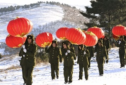 Soldiers carry lanterns to barracks to celebrate upcoming New Year in Shenyang, northeast China's Liaoning province
