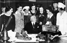 Mr Harry Selfridge (gordon Selfridge Died 1947) At His Desk With Representatives Of His Staff Of Employees And The Silver Casket With Which They Presented Him To Mark The 25th Anniversary Of The Opening Of His Famous Store.