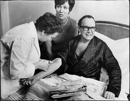 Eric Morecambe Comedian In Hospital Bed Recovering From Heart Attack Receives Injection. Also Shows Wife Joan Morecambe 1968.