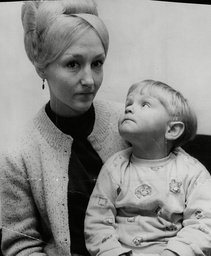 Mrs. Joan Bathram With Her Son Tony (2) Who Ran To Safety After An Explosion And A Ball Of Fire Caused A Scare Near The Ronan Point Area Of Newham. Box 710 217101625 A.jpg.