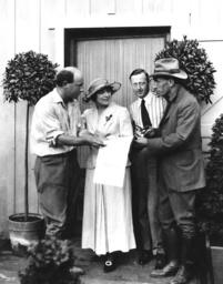 CARMEN, from left, director Cecil B. DeMille, Geraldine Farrar, producer Jesse Lasky, screenwriter W
