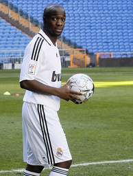 Real Madrid's new midfielder Diarra holds ball during his presentation in Madrid