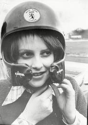 Lady Jane Wellesley Daughter Of Duke Of Wellington And Friend Of Prince Charles In Helmet At Brands Hatch Motor Racing Track 1975.