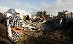 Palestinian man walks past destroyed tunnels near Egyptian border with Gaza Strip