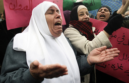 Palestinian women shout slogans during protest in Nablus