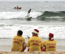 Volunteer lifesavers watch over the surf on Christmas day at Manly Beach in Sydney