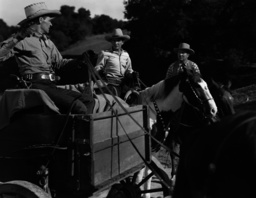 Second from left Bob Steele in one of his numerous westerns, ca 1940s