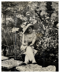A Woman Is Pictured Reading In The Gardens At The 1934 Daily Mail Ideal Home Exhibition At Olympia.