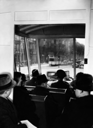 Passengers in a bus, 1936
