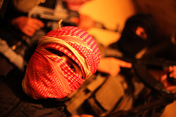 Free Syrian Army fighters, masked with Kalashnikovs