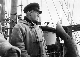 War Britain - Navy - Destroyers - Ships - 1939 - Crews - Deck Scenes ... The Captain Of The Destroyer Looks Out From His Bridge.