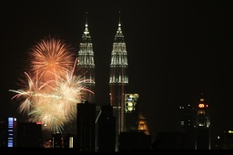 Fireworks explode over Petronas Twin Towers during New Year's celebrations in Kuala Lumpur