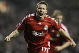 Liverpool's Bellamy celebrates scoring against Watford during their English Premier League soccer match in Liverpool