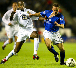 LEEDS UNITED'S DOMI PULLS ON THE SHIRT OF LEICESTER CITY'S DICKOV DURING MATCH AT WALKERS STADIUM