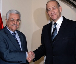 Israel's Prime Minister Ehud Olmert and Palestinian President Mahmoud Abbas shake hands before meeting at the Prime Minister's Jerusalem residence