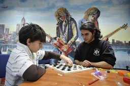 Israelis play checkers in bomb shelter in Ashkelon