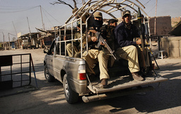 Paramilitary soldiers patrol on a road during a curfew as security forces launched an offensive against militants in Khyber tribal agency outskirts of Peshawar
