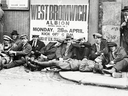 Football Fans Queue On The Morning Of A F.a. Cup Match Outside The Chelsea F.c. Ground At Stamford Bridge.long Railway Journeys And Hours Of Waiting Are Penalties Little Heeded By The Cup's Enthusiates.